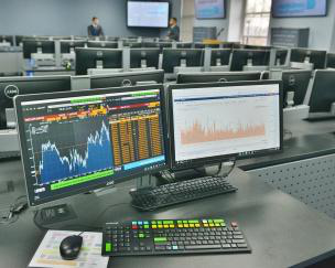 school of business stock trading room computer screen